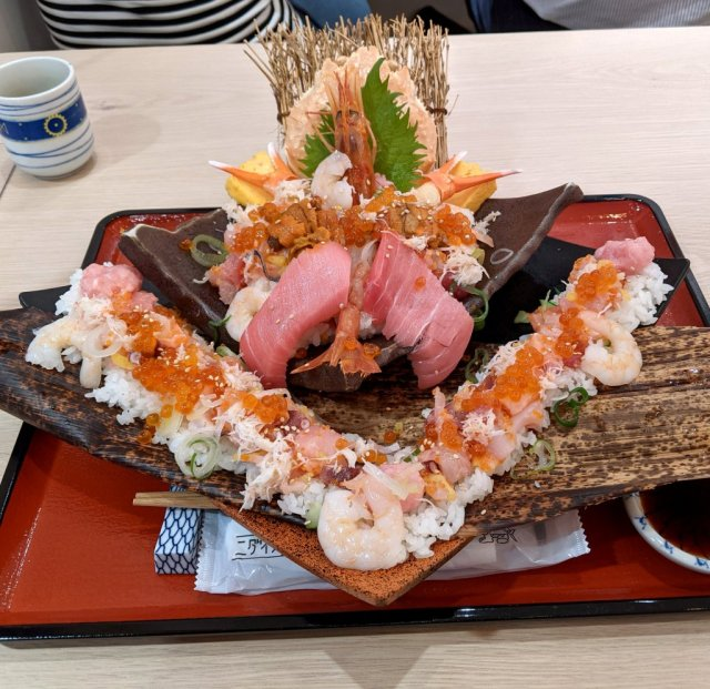 Mr. Sato attacks a massive castle of seafood at a new restaurant in Tokyo Skytree's Solamachi