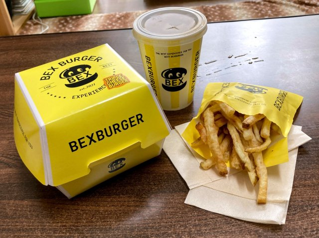 We buy a delicious new burger without saying a single word