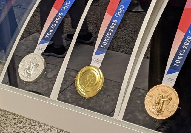 Japanese mayor who bit athlete's gold medal tests positive for coronavirus